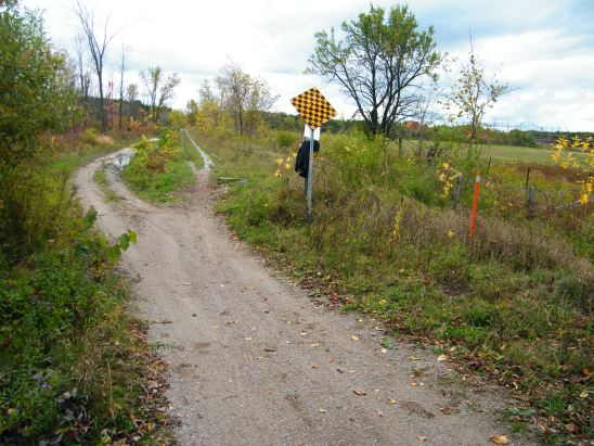 """Sign announcing """"The End of the Trail"""". I ended up keeping to the right , as the left ended up being all mud bogs.mud"""