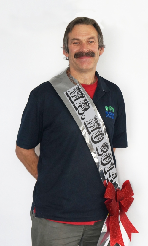 "Proudly wearing championship sash which read, ""Mr. Mo, 2014"""