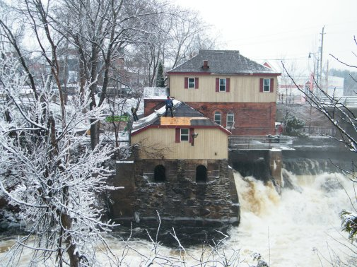 Roofer working precariously over Bracebridge Falls.