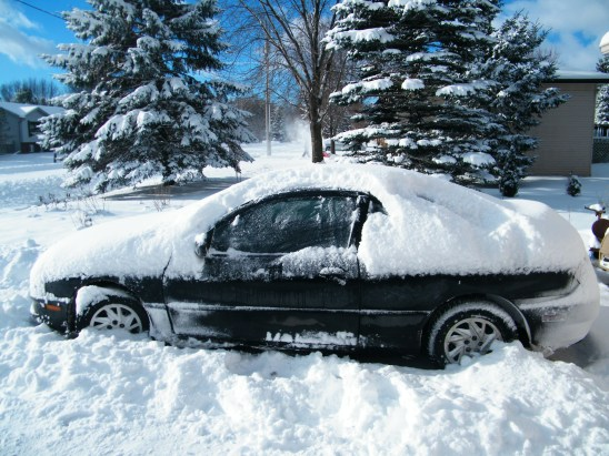 Now where did my car go? Around 25 centimeters of snow arrived overnight. Winter has returned! :)