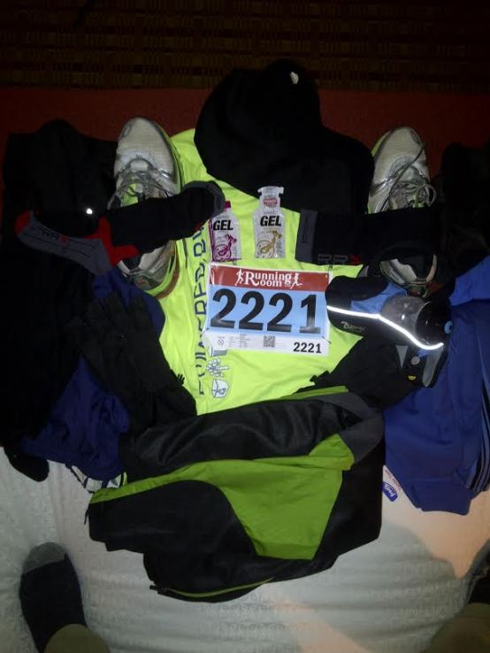 Race day gear laid on the hotel room bed.