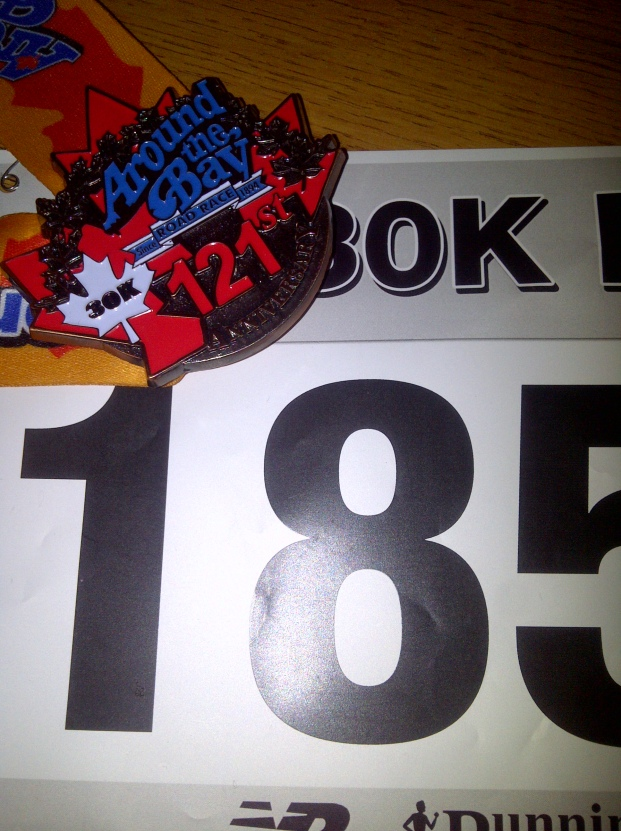 Finisher medal and running bib.