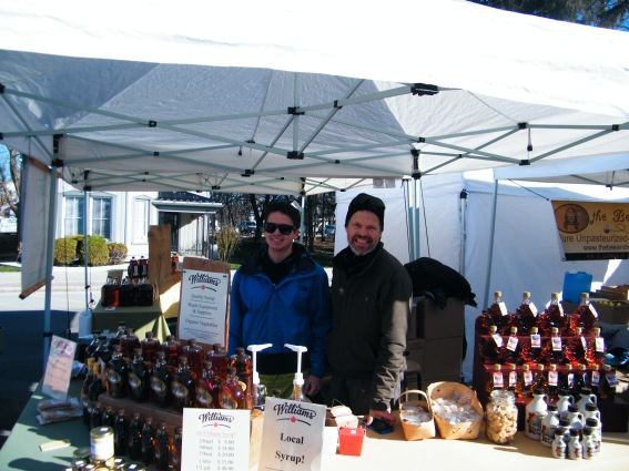 John Williams and his son at the booth at the Elmvale Maple Syrup Festival.