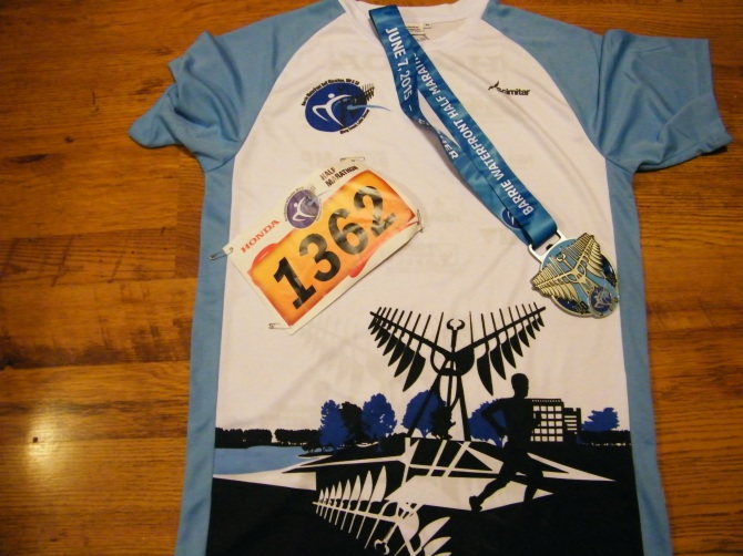 My running bib, cool event jersey, and sweet finishers medal! :)