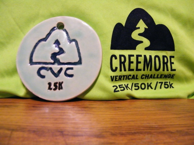My new favourite finisher medal...handcrafted ceramic, with a cherished technical shirt. :)