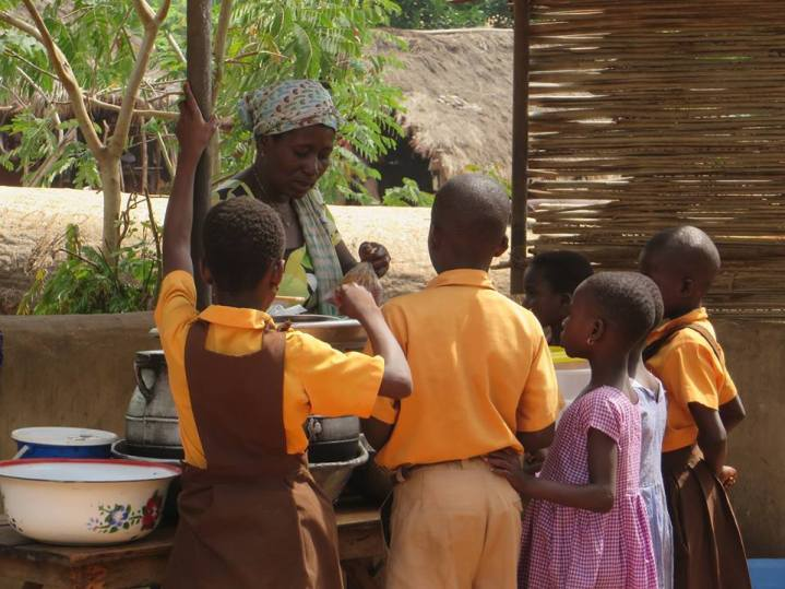 Children provided with a nutritious meal in Dekpor, Ghana. Image via Dekpor Facebook page.