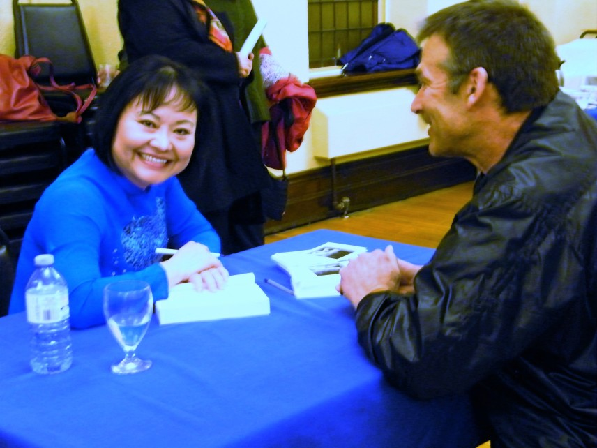 Sharing a laugh while Kim Phuc was signing my copy of her book.