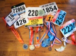 My 9 race bibs from 2015, 7 which had finishers medals.