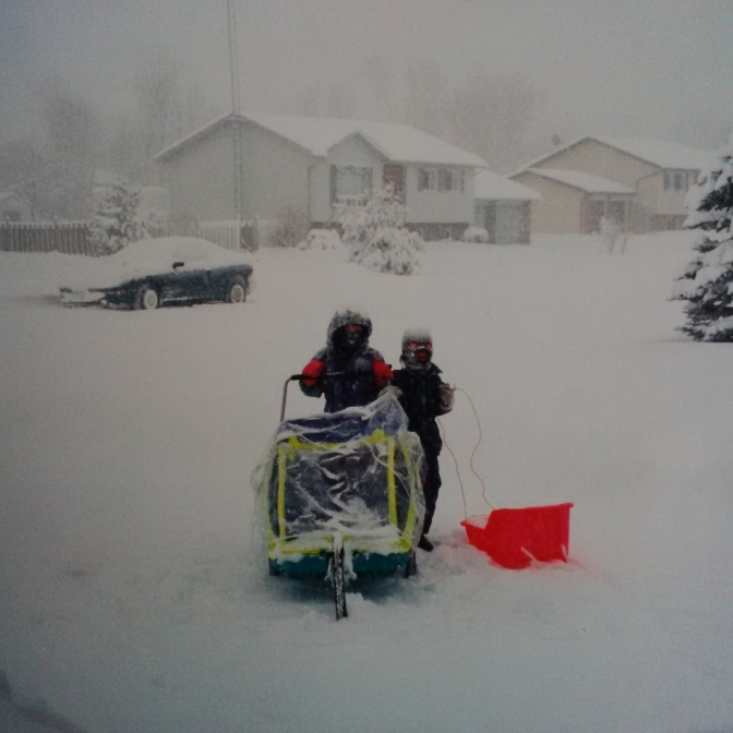 Another picture from the archives of my 2 oldest waiting patiently for either my wife and I to come out and walk with them while they delivered. Such tough warriors. Sunshine, rain, sleet, snowstorm they did their route. :)