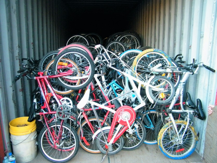 Bikes put away at the end of the day. It is an art to learn how to tightly stack them without any damage to the bike.