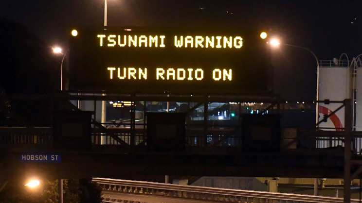 Motorway sign warning of Tsunami, in Wellington, Monday, Nov. 14, 2016, after a major earthquake struck New Zealand's south Island early Monday. A powerful earthquake struck in a mostly rural area close to the city of Christchurch but appeared to be more strongly felt in the capital, Wellington, more than 200 Km (120 miles) away. (Ross Setford/SNPA via AP)